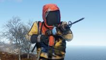 A rad suit amored Rust player runs with a machine gun.