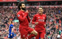 Firmino and Salah celebrate a goal against Chelsea.