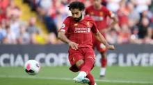 Mohamed Salah shoots to score a goal for Liverpool