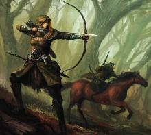 A female ranger with a bow ready to fire