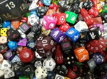 Dice come in all shapes and sizes. Just look at that d20 top in the middle left and the massive d20 in the top left. Incredible variety!