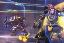 Brigitte and Reinhardt hold their shields up in battle.
