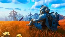 Here a player is sitting down in the middle of a field with a wonderful backdrop.