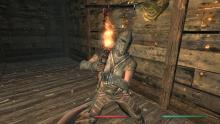 Skyrim Characther Using Fire Enchantment In Battle