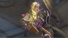 Sombra brandishing her gold gun