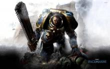 Wallpaper of the Space Marine holding a chain sword.