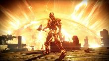 The Solar Titan wields a mace, with a flaming sun behind him.