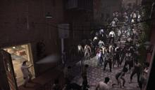 Massive amount of zombies going down stairs to eat man with a gun and a flashlight