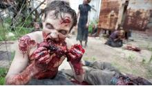 A Walker tears at fresh meat.