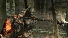 A magic and sword user takes on an Orc in battle.