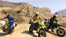 Three dirtbikes getting ready to conquer some mountains in GTA Online.
