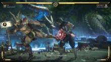 Shao Kahn kicks Scorpion in a painful place.