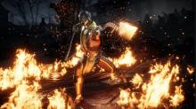 Scorpion shows off his fiery skills with his spear.