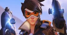 Tracer staring down the camera with a smile on her face