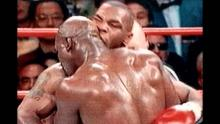 Mike Tyson biting Evander Holyfield's ear in a match.