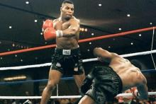 Tyson throwing a knockout punch in the ring.