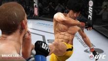 Bruce lee landing a crucial blow to his opponent
