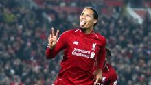 Virgil van Dijk scores a goal for Liverpool and celebrates