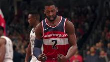 The Wizards point guard celebrates a basket.