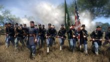 As in typical Civil War tradition, the soldiers stand in a straight line, as to make a wall of fire.