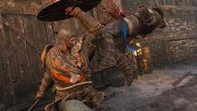 A Warlord uppercuts a Warden with his stout shield