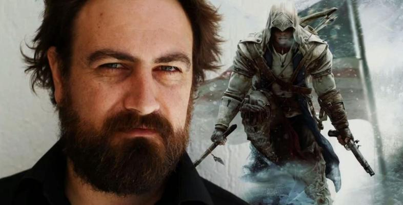 Director of Assassin's Creed, Justin Kurzel, atop a lovely Assassin's Creed backdrop.