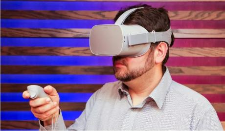 Man playing with the Oculus Go